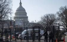 US Capitol police officers and US National Guard soldiers guard an entrance to the Capitol grounds in Washington, DC, on 4 March 2021. Picture: AFP