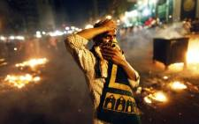 A supporter of the Muslim Brotherhood and of Egypt's ousted President Mohamed Morsi demonstrates in the centre of Cairo.Picture:AFP