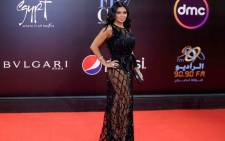 Egyptian actress Rania Youssef poses on the red carpet at the closing ceremony of the 40th edition of the Cairo International Film Festival at the Cairo Opera House in the Egyptian capital on 29 November 2018. Picture: AFP