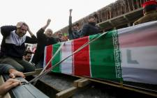Iraqis mourn over a coffin during the funeral procession of Iraqi paramilitary chief Abu Mahdi al-Muhandis and Iranian military commander Qasem Soleimani, and eight others, in Kadhimiya, a Shiite pilgrimage district of Baghdad, on January 4, 2020.  Picture: AFP.