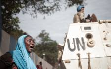 FILE: A woman reacts next to UN soldiers as inhabitants of the mainly Muslim PK5 neighbourhood demonstrate in front of the headquarters of MINUSCA, the UN peacekeeping mission in the Central Africa Republic, in Bangui. Picture: AFP