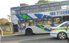 FILE: Police comb the scene for evidence after a Metrobus driver was shot and a passenger wounded in the early hours on 1 April 2015 during a robbery. Picture: Govan Whittles/EWN.