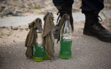 Petrol bombs were confiscated at the illegal housing settlement in Mfuleni. Picture: Anthony Molyneaux/EWN