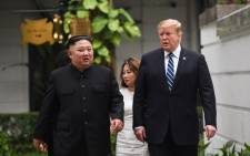 US President Donald Trump (right) walks with North Korea's leader Kim Jong Un during a break in talks at the second US-North Korea summit at the Sofitel Legend Metropole hotel in Hanoi on 28 February 2019. Picture: AFP