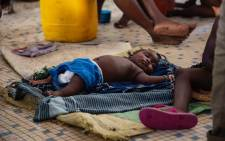 A baby sleeps on the floor in a shelter set up for people displaced by Cyclone Idai. Picture: Christa Eybers/EWN