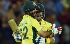 Australian batsmen Glenn Maxwell and Shane Watson celebrates after scoring the winning runs during the 2015 Cricket World Cup quarter-final match between Australia and Pakistan in Adelaide on 20 March, 2015. Picture: AFP.
