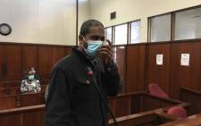 Brandon Naidoo (27) appearing before the Durban Magistrates Court on 22 June 2020. Naidoo faces a charge of extortion after he allegedly tried to defraud the families of Miguel Louw and Sandra Munsamy following their disappearances. Picture: Nkosikhona Duma/EWN