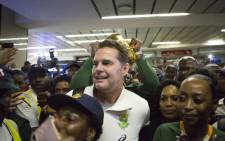 Springbok head coach Rassie Erasmus is surrounded by supporters upon the South African Rugby team's arrival at OR Tambo International Airport in Johannesburg, South Africa on 5 November 2019.  Picture: AFP