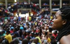 A Wits student watches as SRC representatives address hundreds of students during a sit-in on campus over proposed tuition fee increases. Picture: Reinart Toerien/EWN