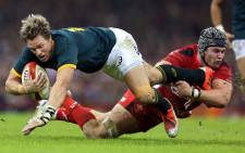 FILE: Jean de Villiers of South Africa is tackled by Dan Lydiate of Wales during the Autumn International rugby union Test match between Wales and South Africa at the Millennium Stadium in Cardiff on 9 November 2014. Picture: AFP.