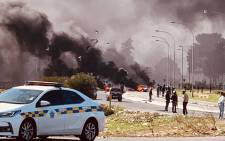 FILE: In this file photo, law enforcement officers are pictured on scene where Kraaifontein residents barricaded roads after their homes were demolished on 26 July 2020. Picture: Supplied.
