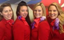 Virgin Atlantic crew getting involved in the #nomakeupselfie. Picture: Richard Branson/Twitter.