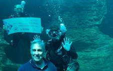 Representatives from Sanccob and NSRI were each presented with a check of R15,000. Picture: Twitter @2OceansAquarium.