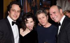 Actors Sally Hawkins and Frances McDormand (both C) with Fox Searchlight Co-Heads of Production David Greenbaum (L) and Matthew Greenfield (R) attend FOX, FX and Hulu 2018 Golden Globe Awards After Party at The Beverly Hilton Hotel on January 7, 2018 in Beverly Hills. Picture: AFP.