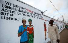 FILE: A Liberian man looks at an Ebola sensitisation campaign painted on a wall in downtown Monrovia, Liberia 19 November 2014. Picture: EPA.