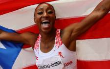 Puerto Rico's Jasmine Camacho-Quinn reacts after winning the women's 100m hurdles final during the Tokyo 2020 Olympic Games at the Olympic Stadium in Tokyo on 2 August 2021. Picture: Kai Pfaffenbach/AFP