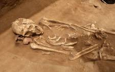 This file photo taken on 28 June 2016 in the Mediterranean coastal Israeli city of Ashkelon, shows a skeleton discovered at the excavation site of the first Philistine cemetery ever found. Picture: AFP