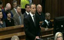 Oscar Pistorius stands in the dock at the High Court in Pretoria as Judge Thokozile Masipa rules on an application to have him referred for mental observation, 14 May 2014. Picture: Live feed