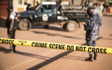 A crime scene following a bomb blast is secured by the Ugandan police in Kampala on 24 October 2021. Picture: AFP