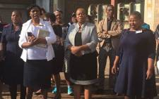 Gauteng Health MEC Gwen Ramokgopa (centre) leads a short burial service for 41 of the 42 unidentified bodies which were transported in an open trailer last week. Picture: EWN