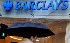 FILE: A pedestrian passing a Barclays bank branch in London, Britain. Picture: EPA/Andy Rain
