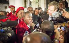 EFF leader Julius Malema addresses media outside Parliament after he was ejected from the National Assembly along with several other party MPs during the 2015 State of the Nation Address. Picture: Thomas Holder/EWN