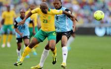 Bafana Bafana's Tokelo Rantie vies with Botswana's Mogogi Gabonamong during a 2014 Soccer World Cup Qualifying match at The Moses Mabhida Stadium in Durban on 7 September 2013. Picture: AFP/ANESH DEBIKY""