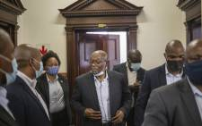 Former South African President Jacob Zuma (C) greets his supporters inside a police station in Pietermaritzburg on 21 October 2021 where Zuma is laying a criminal complaint against Billy Downer, the state's chief prosecutor in his corruption case. Picture: Michele Spatari/AFP