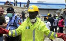 Spokesman of the National Emergency Management Authority (NEMA) southwest region, Ibrahim Farinloye, speaks about the casuality figure at the scene of the collapsed church guesthouse of the Synagogue Church of All Nations (SCOAN) in the Ikotun neighborhood in Lagos on 17 September, 2014.