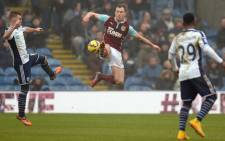 Burnley's English striker Ashley Barnes (C) controls the ball during the English Premier League football match between Burnley and West Bromwich Albion at Turf Moor in Burnley, north west England, on 8 February, 2015. Picture: AFP.