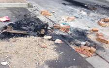 FILE:It's believed a mob of angry residents allegedly beat and burnt a man to death in Masiphumelele Township. Picture: Lauren Isaacs/EWN.