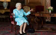 Britain's Queen Elizabeth II smiles while speaking with Scotland's First Minister Nicola Sturgeon (not pictured) during an audience at the Palace of Holyroodhouse in Edinburgh on 29 June 2021.  Picture: Jane Barlow/AFP