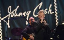 Singer Randy Travis performs at the Johnny Cash Limited-Edition Forever Stamp launch at Ryman Auditorium on 5 June 2013 in Nashville, Tennessee. Picture: Rick Diamond/Getty Images/AFP