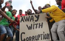 Hundreds of Numsa members and other parties sang and danced through the streets of Johannesburg's CBD as part of an anti-corruption march on 14 October 2015. Picture: Reinart Toerien/EWN