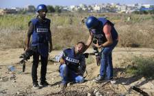 A Palestinian photographer was wounded during clashes between Palestinian protestors and Israeli security forces near the border fence between Israel and the Gaza Strip on 11 October, 2015, east of Gaza City. Picture: AFP.