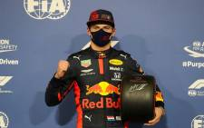 Red Bull's Dutch driver Max Verstappen poses for a picture with the Pole Position trophy after the qualifying session on the eve of the Abu Dhabi Formula One Grand Prix at the Yas Marina Circuit in the Emirati city of Abu Dhabi on December 12, 2020. Picture: AFP