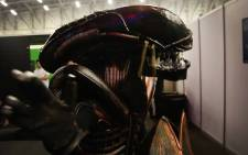 A visitor to the Electronics and Gaming Expo at the CTICC dressed up as a Xenomorph from the movie aliens. Photo: Bertram Malgas