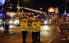 GLASGOW: Emergency services gather at the site where a police helicopter crashed into a pub in central Glasgow, Scotland, shortly after midnight on 30 November 2013. It crashed into the Clutha pub and Scotland's First Minister Alex Salmond says fatalities are likely. Picture: AFP/ANDY BUCHANAN