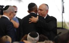 US President Barack Obama (C) greets Chemi Peres, the son of former Israeli president and Nobel Peace Prize winner Shimon Peres, next to Israeli Prime Minister Benjamin Netanyahu (L) during Peres' funeral at Jerusalems Mount Herzl national cemetery on 30 September, 2016. Picture: AFP.