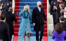 US President-elect Joe Biden flanked by wife Dr Jill Biden arriving for his inauguration as the 46th US President on 20 January 2021, at the US Capitol in Washington, DC. Picture: Patrick Semansky/AFP