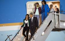 US President Barack Obama and First Lady Michelle Obama walk off Air Force One with their daughters Malia and Sasha at Waterkloof Air Force Base on June 28, 2013.  Picture: AFP