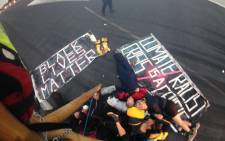 "Members of ""Black Lives Matter"" during a protest on a runway at London City Airport. Picture: Twitter/@ukblm."