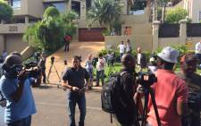 FILE: Media contingent waiting outside Oscar Pistorius's uncle's house in Waterkloof after he was released on parole on 19 October 2015 evening. Picture: Christa Eybers/EWN.