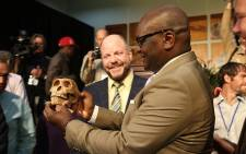 Gauteng Premier David Makhura holds a reconstructed skull of the newly discovered 'Neo' of the Homo Naledi species.  Picture: Christa Eybers/EWN