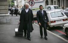 Shrien Dewani's legal team, Francois van Zyl, arriving at the Western Cape High Court with Dewani's brother on 22 October 2014. Picture: Thomas Holder/EWN.