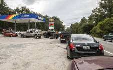 People line up for gasoline as Hurricane Michael bears down on the northern Gulf coast of Florida on October 8, 2018 outside Tallahassee, Florida. Picture: AFP.