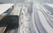 A train pasts snow-covered rails in Berlin, Germany. Picture: Andreas Rentz/Getty Images