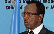 Somalia's Prime Minister Abdi Farah Shirdon speaks during a news conference at the presidential palace in Mogadishu on 2 December, 2013. Picture: AFP