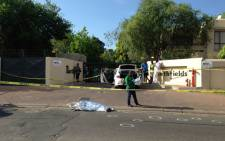 One suspect was killed and another arrested when a gang of men followed a diplomat home to Magaliesig from the OR Tambo International Airport on Saturday 28 September 2013. Picture: Mia Lindeque/EWN