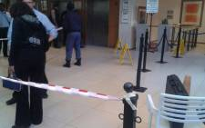 People and police at the scene of a shooting at Netcare Linksfield Hospital on 18 August 2014. Picture: @MedixGauteng via Twitter.